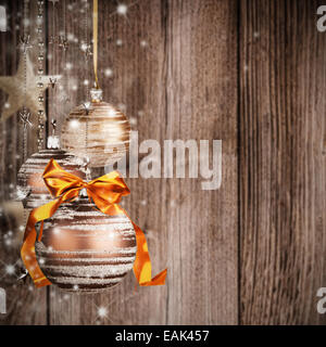 Christmas theme with golden glass balls on blur wooden texture - Stock Photo