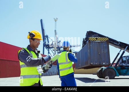 Workers near cargo containers - Stock Photo
