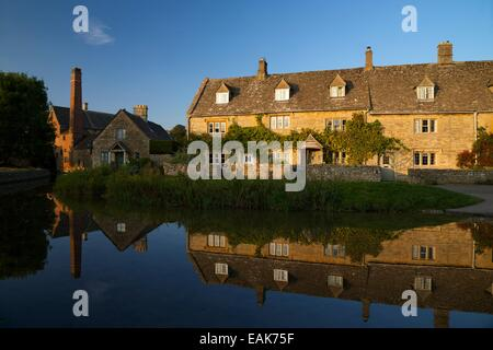 Old Mill and cottages by River Windrush, Lower Slaughter, Cotswolds, Gloucestershire, England, UK, GB - Stock Photo