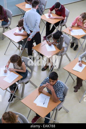 Elevated view of students writing their GCSE exam - Stock Photo