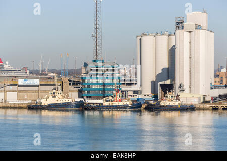 Tugs moored at the quayside, Southampton Docks, Port of Southampton, the Solent, Hampshire, UK - Stock Photo