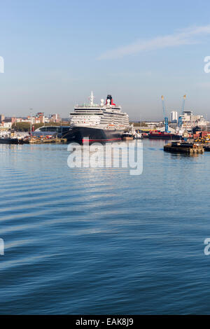 The Cunard cruise liner 'Queen Victoria' moored at Southampton Docks on the Solent, Hampshire, UK - Stock Photo