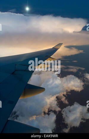 View from a Boeing 747-400 of a storm front at full moon, Australia - Stock Photo