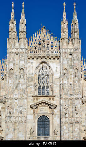 Spires, towers and windows of the west facade of Milan Cathedral or Duomo di Santa Maria Nascente, Milan, Lombardy, - Stock Photo