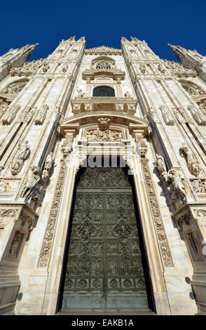 Bronze main door with scenes from the life of Mary, sculptor Lodovico Pogliaghi, west facade of Milan Cathedral - Stock Photo
