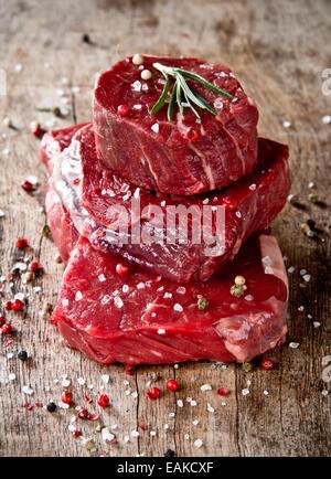 Fresh raw beef steak on wood - Stock Photo