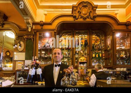 Waiter with wine bottles and glasses, Café Majestic, Art Nouveau cafe, Porto, District of Porto, Portugal - Stock Photo