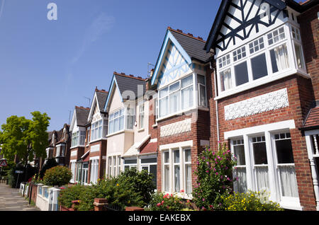 Row of terraced houses in Crouch End, London, England, UK - Stock Photo