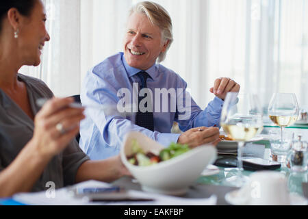 Smiling business people having lunch in restaurant - Stock Photo