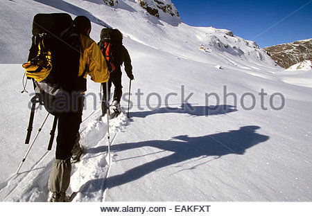 Snowshoeing men, Hautes-Pyrenees, France. - Stock Photo