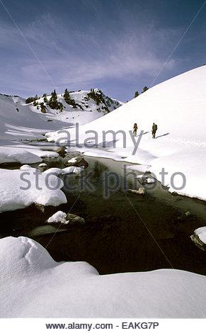 Snowshoeing men near Bastan lake, Hautes-Pyrenees, France. - Stock Photo