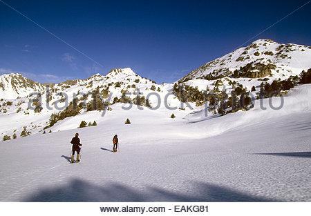 Snowshoeing men, Madamete pass. Hautes-Pyrenees, France. - Stock Photo