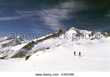 Snowshoeing men. Neouvielle massif from Madamete pass, Hautes-Pyrenees, France. - Stock Photo