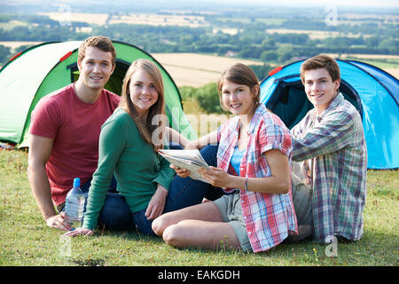 Group Of Young Friends Camping In Countryside - Stock Photo