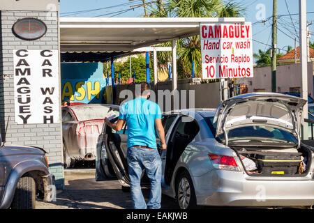 Miami Florida Little Havana car wash business line queue Spanish language - Stock Photo