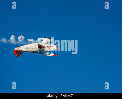 An aerobatics aircraft flying upside down at the Lowveld Air Show - Stock Photo