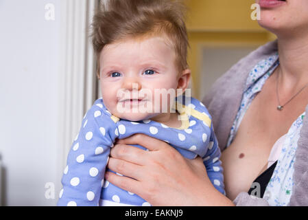 Three Month Old Baby Girl Grasping And Mouthing A Teething