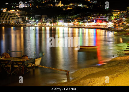 The beach, tavernas and bars in night illumination, Crete island, Greece - Stock Photo