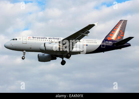 Brussels Airlines Airbus A319 approaches runway 27L at London Heathrow Airport. - Stock Photo