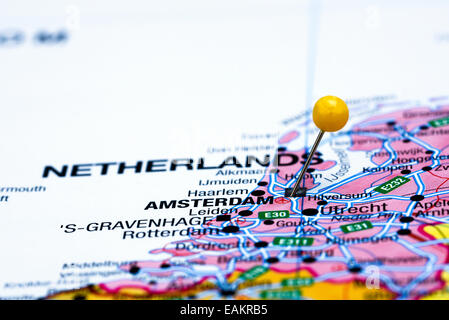 Close Up Of Amsterdam Netherlands Map With Red Pin And Airplane - Amsterdam map in europe