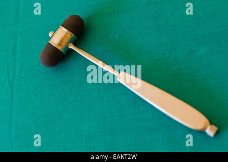 A reflex hammer is a medical instrument used by physicians to test deep tendon reflexes - Stock Photo