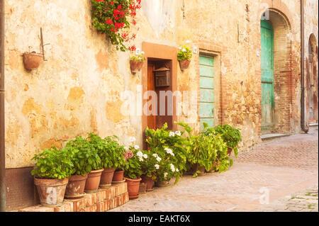 Sunny streets of Italian city Pienza in Tuscany - Stock Photo