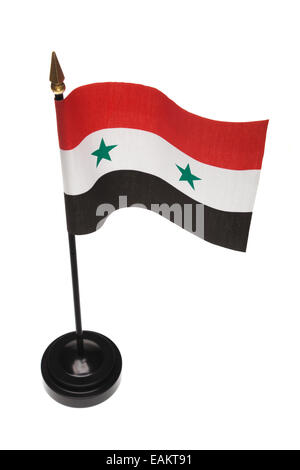 Small flag of Syria in a stand isolated on a white background. High angle. - Stock Photo