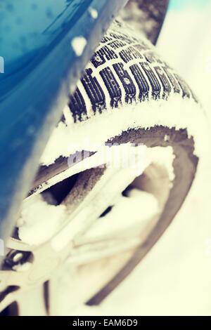 closeup of car winter tire - Stock Photo