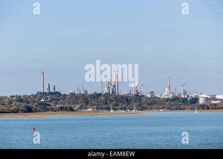 Exxon Mobil oil refinery with cooling towers, stacks and storage tanks on Southampton Water, the Solent at Fawley, - Stock Photo
