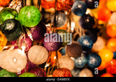colorful decorative lights in a thai market stall in bangkok - Stock Photo