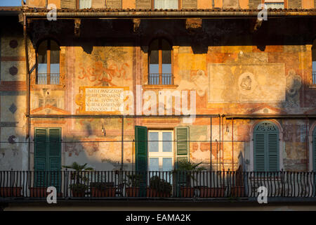 Setting sunlight on the historic buildings surrounding Piazza delle Erbe, Verona, Veneto, Italy - Stock Photo
