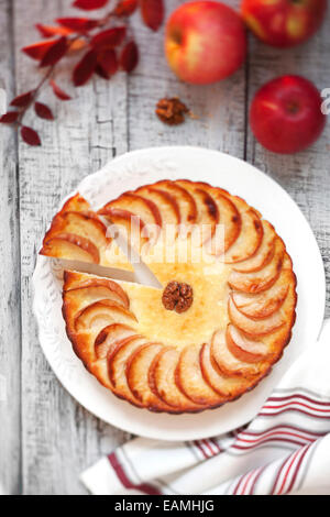 Apple tart on a wooden table - Stock Photo