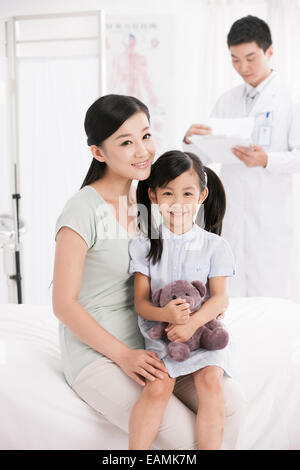 Mother holding the daughter sitting room - Stock Photo