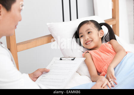 The doctor is to visit the girl - Stock Photo