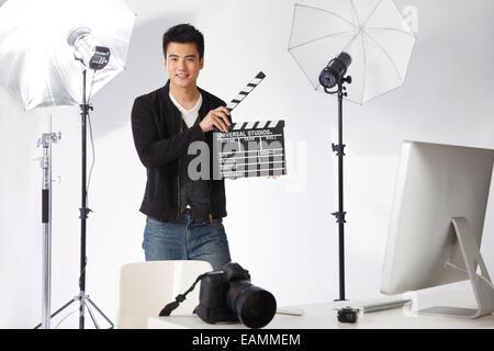 Oriental men waiting in the film studio - Stock Photo