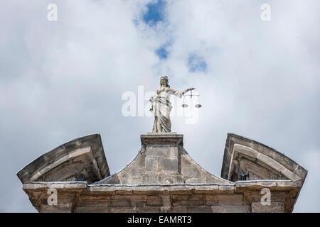 Justice woman statue at Dublin Castle in Dublin, Ireland - Stock Photo