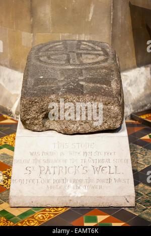 Stone with The Saint Patricks Cross found near to The Saint Patricks Cathedral in Dublin, Ireland - Stock Photo