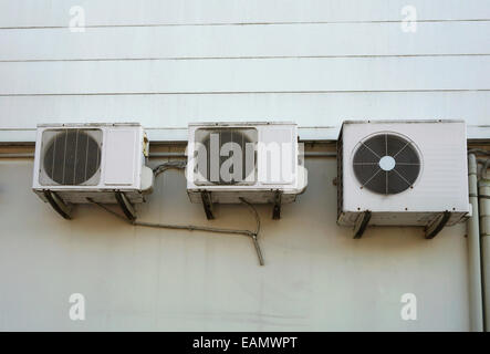 Air conditioning units on side of building. - Stock Photo