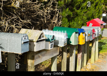 A row of post boxes on a rural road in New Zealand South Island - Stock Photo