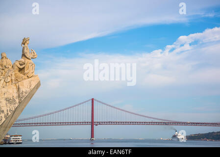 Monument to the Discoveries and  25th of April Bridge, Lisbon, Portugal - Stock Photo
