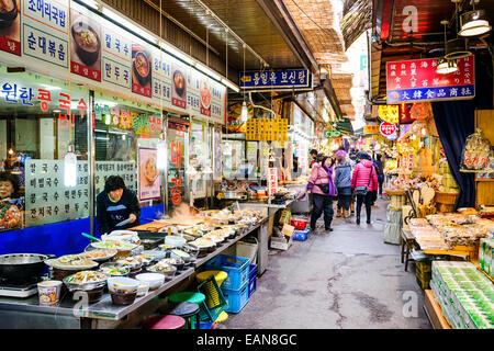 Shoppers pass through Dongdaemun Market. The market is a popular shopping and tourist destination.