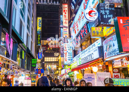 Myeong-Dong district at night in Seoul. The location is the premiere district for shopping in the city. - Stock Photo