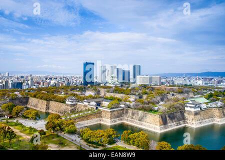 Osaka, Japan city skyline with Osaka Castle. - Stock Photo