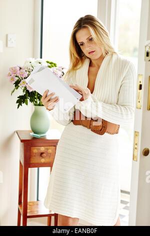 Woman looking at post - Stock Photo