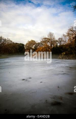 misty frosty morning on lake in winter - Stock Photo