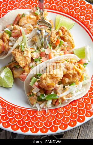 Shrimp Tacos on a red and white plate - Stock Photo
