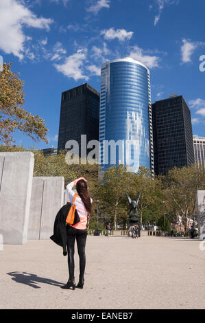 Young woman photographing American Eagle statue battery park East Coast war Memorial  Manhattan, New York, USA - Stock Photo