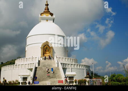 POKHARA, NEPAL - OCTOBER 12: Devotees and tourists visit the Shanti Stupa-World Peace Pagoda-Ananda Hill overlooking - Stock Photo