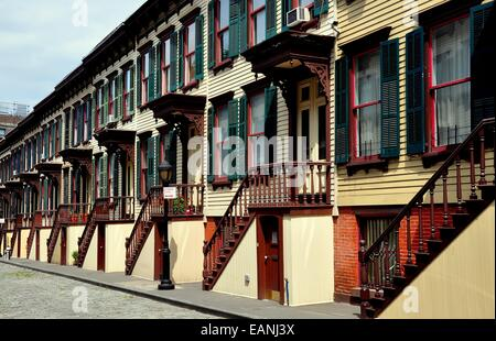 NYC:  Unique two story 1882 wooden row houses with stairway stoops and basement entry doors on Sylvan Terrace * - Stock Photo