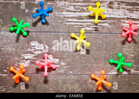 Colorful plastic toys on a wooden surface - Stock Photo